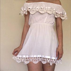 Off the shoulder white dress.